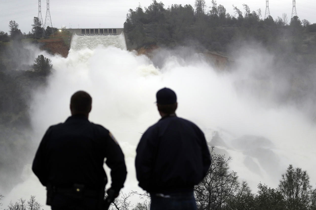 <p>Two men watch as water gushes from the Oroville Dam's main spillway, Feb. 15, 2017, in Oroville, Calif. (AP Photo/Marcio Jose Sanchez) </p>