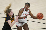 Maryland's Diamond Miller (1) goes to the basket against Iowa's Kate Martin (20) during the first half of an NCAA college basketball game in the championship of the Big Ten Conference tournament, Saturday, March 13, 2021, in Indianapolis. (AP Photo/Darron Cummings)