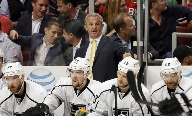 Los Angeles Kings head coach Darryl Sutter directs his team during the first period in Game 5 of the Western Conference finals in the NHL hockey Stanley Cup playoffs against the Chicago Blackhawks, Wednesday, May 28, 2014, in Chicago. (AP Photo/Nam Y. Huh)