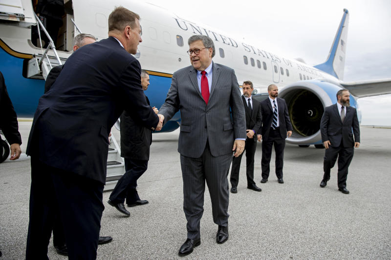 Attorney General William Barr greets members of the Cleveland FBI field office's SWAT team before boarding an aircraft at Burke Lakefront Airport, Thursday, Nov. 21, 2019, in Cleveland. Barr participated in a roundtable discussion with members of local, state and federal law enforcement, and is en route to Montana, where he is scheduled Friday to address missing and murdered indigenous persons. (AP Photo/Patrick Semansky)