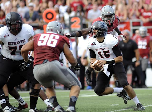 Southern Utah quarterback Aaron Cantu looks to pass against Washington State's Xavier Cooper (96) and Kache Palacio (40) during the first half of an NCAA college football game, Saturday, Sept. 14, 2013, in Pullman, Wash. (AP Photo/Rajah Bose)