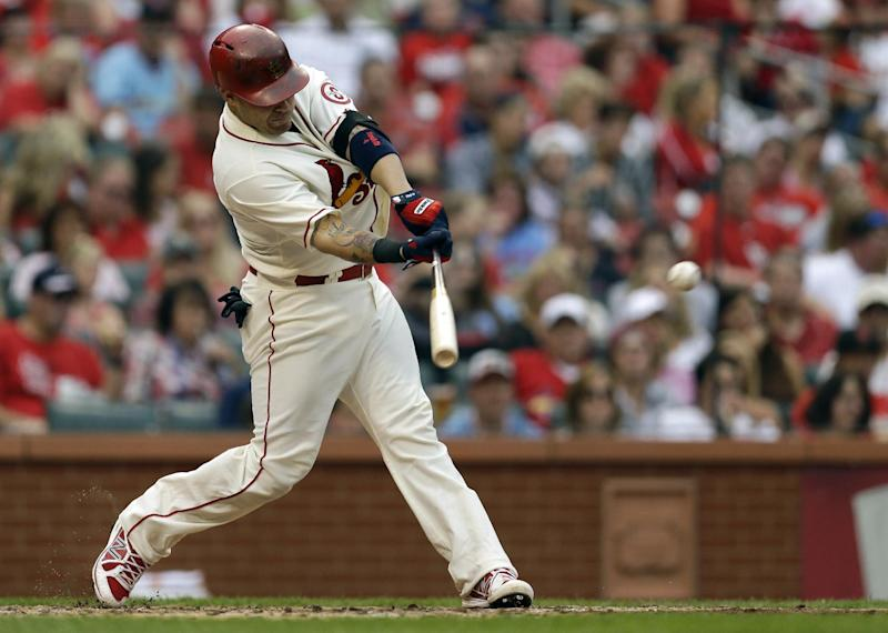 St. Louis Cardinals' Yadier Molina hits a two-run double during the third inning of a baseball game against the Chicago Cubs, Saturday, Sept. 28, 2013, in St. Louis. (AP Photo/Jeff Roberson)