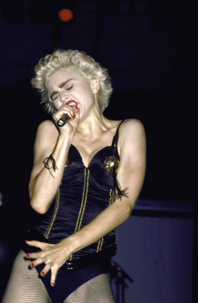 <p>The singer's love for corsets began to surface during her 'Who's That Girl' global tour. This black leather look boasted zips and nipple tassles. <em>[Photo: Getty]</em> </p>