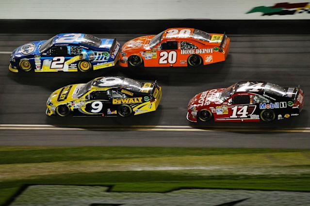 DAYTONA BEACH, FL - FEBRUARY 27: Brad Keselowski, driver of the #2 Miller Lite Dodge, Marcos Ambrose, driver of the #9 Stanley Ford, Joey Logano, driver of the #20 The Home Depot Toyota, and Tony Stewart, driver of the #14 Office Depot/Mobil 1 Chevrolet, race during the NASCAR Sprint Cup Series Daytona 500 at Daytona International Speedway on February 27, 2012 in Daytona Beach, Florida. (Photo by Streeter Lecka/Getty Images)