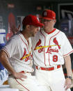 St. Louis Cardinals manager Mike Shildt (8), right, talks with starting pitcher Adam Wainwright (50) after Wainwright was pulled from the mound during the fifth inning of a baseball game against the Chicago Cubs, Saturday, Sept. 28, 2019, in St. Louis. (AP Photo/Scott Kane)