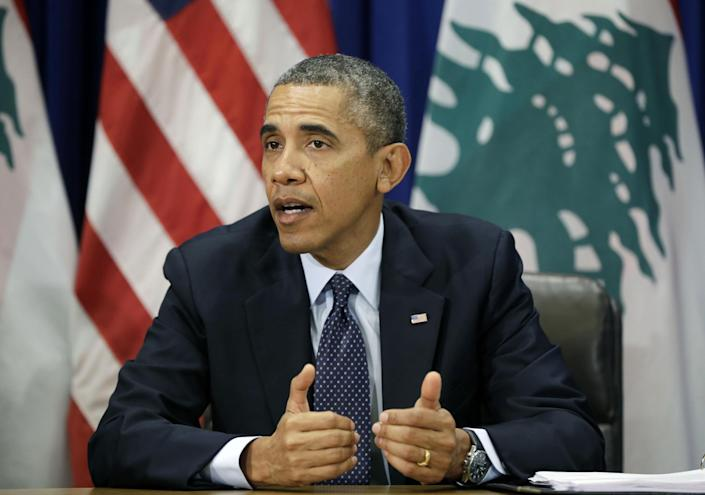 President Barack Obama gestures while speaking during a bilateral meeting with Lebanese President Michel Suleiman, not shown, at the United Nations headquarters, Tuesday, Sept. 24, 2013. (AP Photo/Pablo Martinez Monsivais)