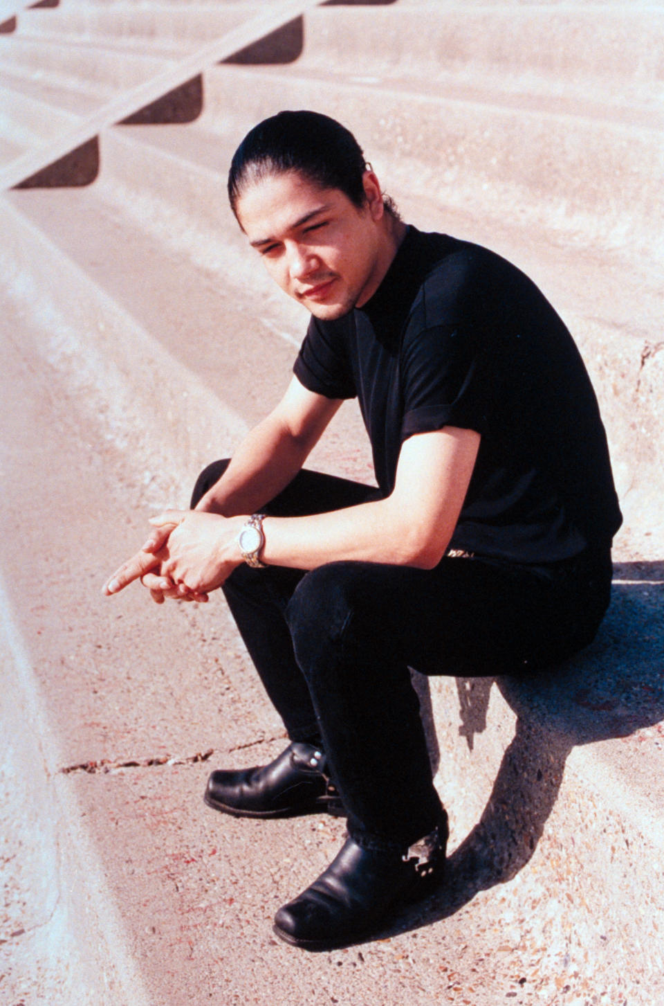 Chris Perez, husband of slain tejano singer Selena, posing outside on concrete steps.  (Photo by Barbara Laing/The LIFE Images Collection via Getty Images/Getty Images)