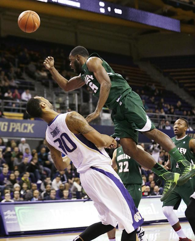 Mississippi Valley State's Jeffrey Simmons, right, tumbles on a shot as Washington's Desmond Simmons defends in the first half of an NCAA men's basketball game, Friday, Dec. 27, 2013, in Seattle. (AP Photo/Elaine Thompson)