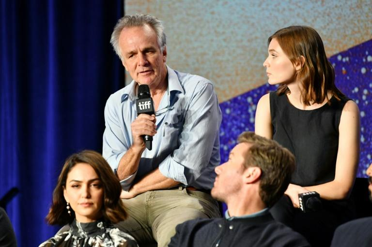 "TORONTO: John Collee (L) and Tilda Cobham-Hervey speaks onstage at ""Hotel Mumbai"" Press Conference during 2018 Toronto International Film Festival"