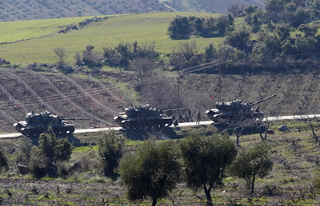 <p>Turkish Army tanks are seen near the Turkish-Syrian border in Kilis province, Turkey, Jan. 31, 2018. (Photo: Osman Orsal/Reuters) </p>