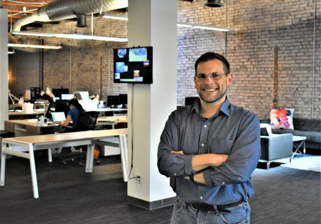 First Mode's president and chief engineer, Chris Voorhees, shows off the employee-owned company's digs near Seattle's Pike Place Market. (GeekWire Photo / Alan Boyle)