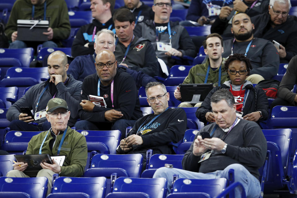 A group of coaches and scouts from various NFL teams observe the action during the NFL Combine at Lucas Oil Stadium in 2019. If there is a combine in 2021, prospects' workout numbers, testing and even positional drills there likely will carry extra weight in draft evaluations. (Joe Robbins/Getty Images)