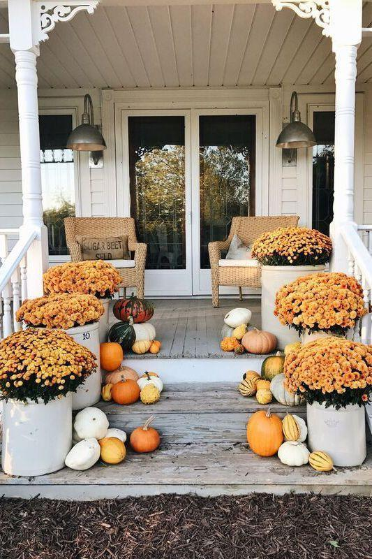 """<p>You've waited all year to display them, and now's your chance! Fall mums are a welcome addition to any front yard or porch. (Here, smaller gourds add visual interest and extra color.)</p><p><strong>See more at <a href=""""https://www.lizmarieblog.com/2017/10/eclectic-pumpkin-fall-porch-steps/"""" rel=""""nofollow noopener"""" target=""""_blank"""" data-ylk=""""slk:Liz Marie Blog"""" class=""""link rapid-noclick-resp"""">Liz Marie Blog</a>.</strong></p><p><strong><a class=""""link rapid-noclick-resp"""" href=""""https://go.redirectingat.com?id=74968X1596630&url=https%3A%2F%2Fwww.walmart.com%2Fsearch%2F%3Fquery%3Dfaux%2Bpumpkins&sref=https%3A%2F%2Fwww.thepioneerwoman.com%2Fhome-lifestyle%2Fdecorating-ideas%2Fg36732301%2Foutdoor-fall-decorations%2F"""" rel=""""nofollow noopener"""" target=""""_blank"""" data-ylk=""""slk:SHOP FAUX PUMPKINS"""">SHOP FAUX PUMPKINS</a></strong></p>"""