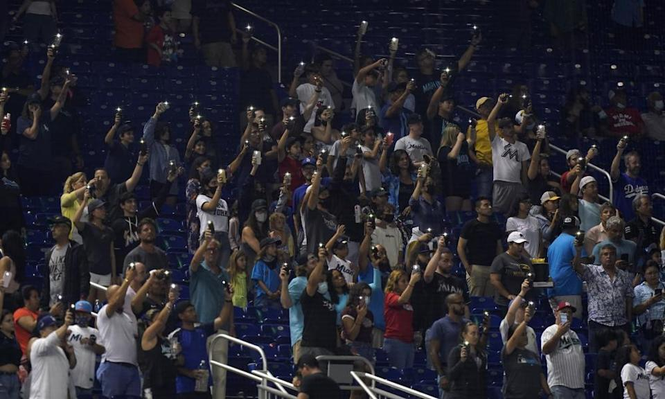 Baseball fans pay tribute to the victims of the condo collapse in Surfside, Florida after a baseball game between the Miami Marlins and the LA Dodgers on Monday.