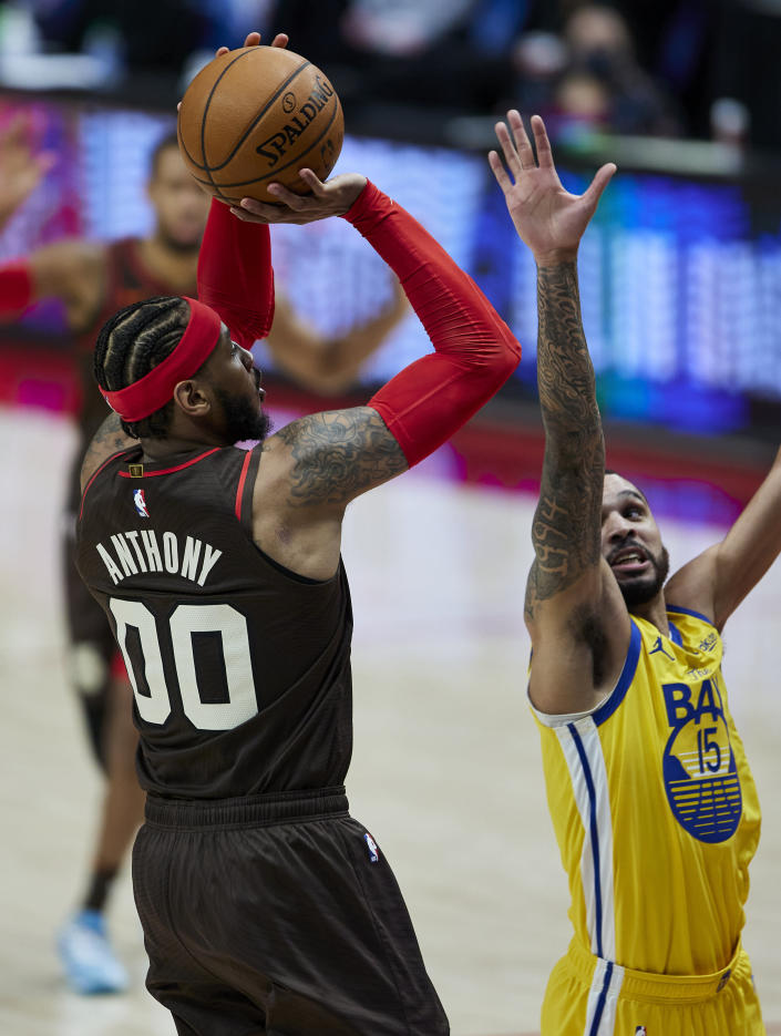 Portland Trail Blazers forward Carmelo Anthony, left, shoots over Golden State Warriors guard Mychal Mulder during the second half of an NBA basketball game in Portland, Ore., Wednesday, March 3, 2021. (AP Photo/Craig Mitchelldyer)