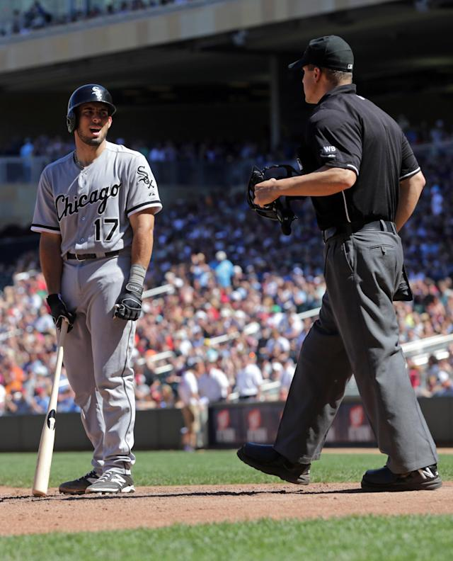 Chicago White Sox' Adrian Nieto, left, disputes a call after he was called out by plate umpire Chris Segal in the eighth inning of a baseball game against the Minnesota Twins, Saturday, June 21, 2014, in Minneapolis. The Twins won 4-3. (AP Photo/Jim Mone)