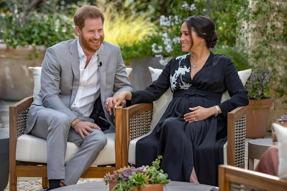"""<p>During the couple's March interview with Oprah, they discussed some of Archie's first words and milestones, and Meghan gave a glimpse into their son's silly sense of humor.</p> <p>""""He's on a roll. In these past couple weeks, [his favorite word] has been 'hydrate,' which is just hysterical,"""" <a href=""""https://people.com/royals/meghan-markle-prince-harry-oprah-interview-archie-beach-video/"""" rel=""""nofollow noopener"""" target=""""_blank"""" data-ylk=""""slk:she said"""" class=""""link rapid-noclick-resp"""">she said</a>.</p>"""