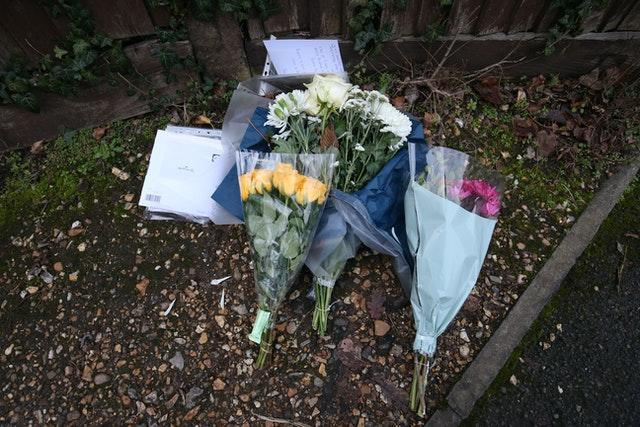 Floral tributes and cards left outside Highdown School in Reading