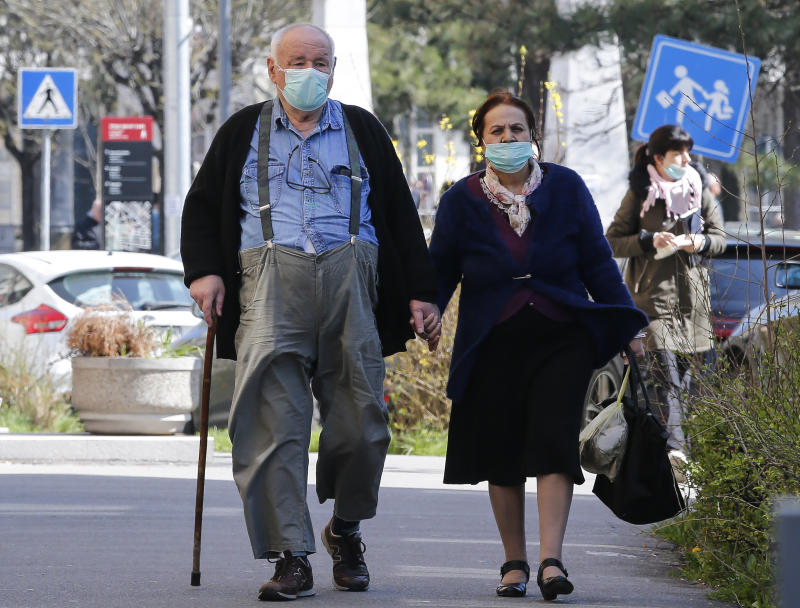BELGRADE, SERBIA - 17 MARCH: An elderly couple wear protective masks in Belgrade on March 16, 2020 in Belgrade, Serbia. Serbian President Aleksandar Vucic had declared the state of emergency to stop the spread of the coronavirus on march 15th, 2020. Many public spaces are shut and soldiers are guarding hospitals. (Photo by Srdjan Stevanovic /Getty Images)