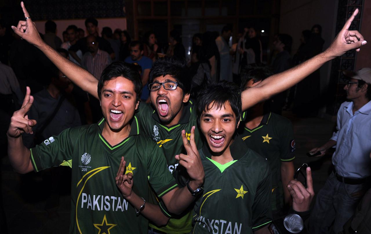 Pakistani cricket fans celebrate the Asia Cup victory in Karachi on March 22, 2012. Pakistan recorded a thrilling two-run victory over Bangladesh in a dramatic final to take the Asia Cup tournament in Dhaka.  AFP PHOTO/Rizwan TABASSUM (Photo credit should read RIZWAN TABASSUM/AFP/Getty Images)