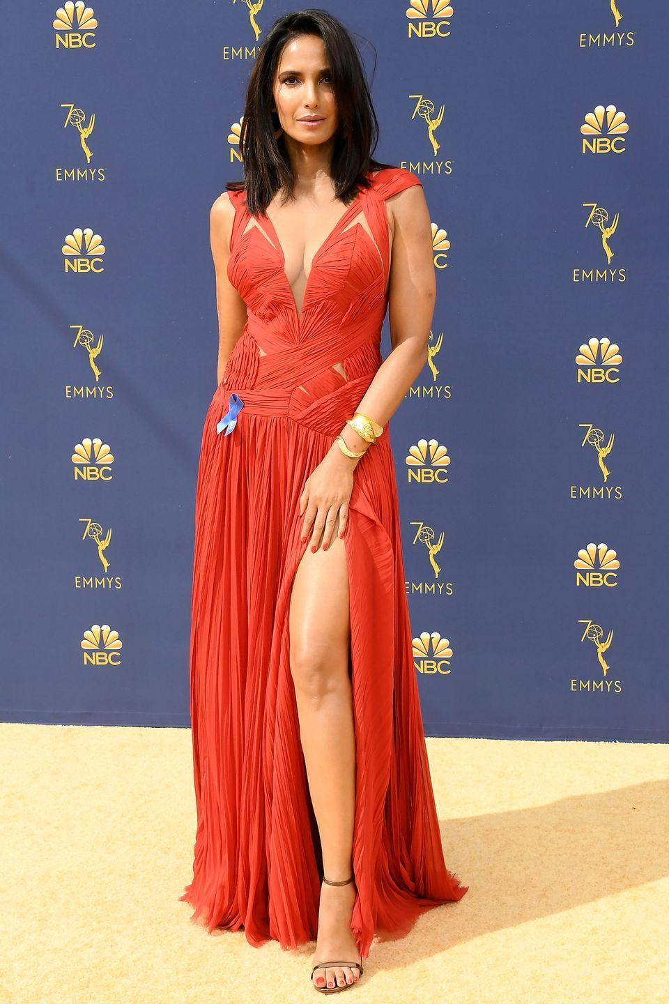 <p>The <em>Top Chef </em>host wore this plunging v-neck gown by designer J. Mendel to the awards show last year. The fiery red bodice featured tiny cutouts along Padma's torso.</p>