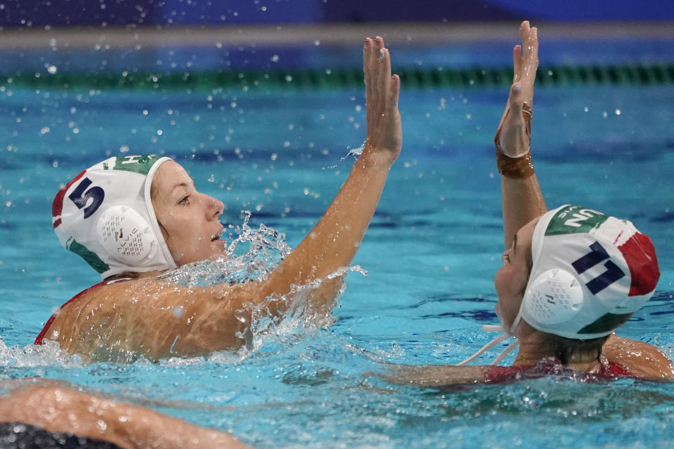 Hungary's Gabriella Szucs (5) and Natasa Rybanska (11) celebrate after a win over the United States in a preliminary round women's water polo match at the 2020 Summer Olympics, Wednesday, July 28, 2021, in Tokyo, Japan. (AP Photo/Mark Humphrey)