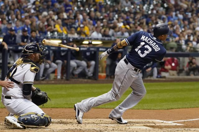 San Diego Padres' Manny Machado hits a single during the fourth inning of a baseball game against the Milwaukee Brewers Tuesday, Sept. 17, 2019, in Milwaukee. (AP Photo/Morry Gash)