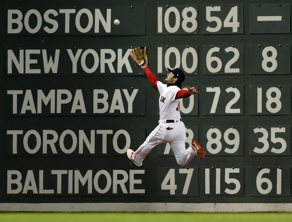 Andrew Benintendi makes a leaping catch against the wall hit by Brian Dozier in the fifth inning of Game 2 of the World Series. The Boston Red Sox host the Los Angeles Dodgers in Game 2 of the World Series at Fenway Park. (Jim Davis/Globe staff)