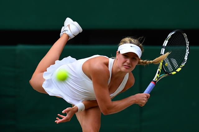 Canada's Eugenie Bouchard serves to Czech Republic's Petra Kvitova during their women's singles final on day 12 of the Wimbledon Championships at The All England Tennis Club in southwest London, on July 5, 2014 (AFP Photo/Carl Court)