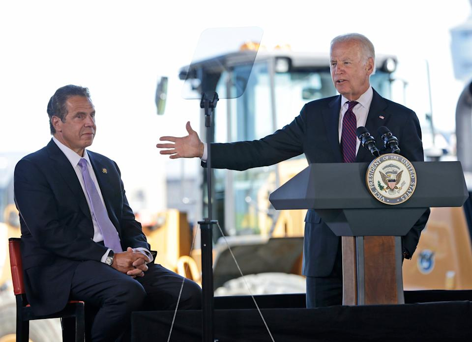 While New York Gov. Andrew Cuomo, left, looks on, then-Vice President Joe Biden speaks during a news conference at LaGuardia Airport in New York, Tuesday, June 14, 2016. Cuomo and Biden were helping to announce and break ground on major infrastructure improvements at the airport.