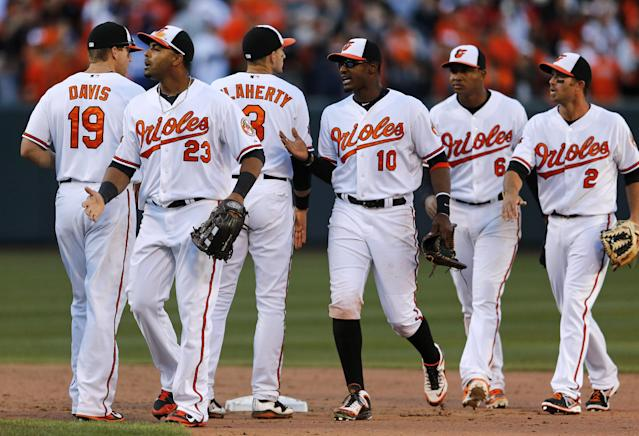 Baltimore Orioles' Nelson Cruz (23) greets teammates after an opening day baseball game against the Boston Red Sox, Monday, March 31, 2014, in Baltimore. Baltimore won 2-1. (AP Photo/Patrick Semansky)