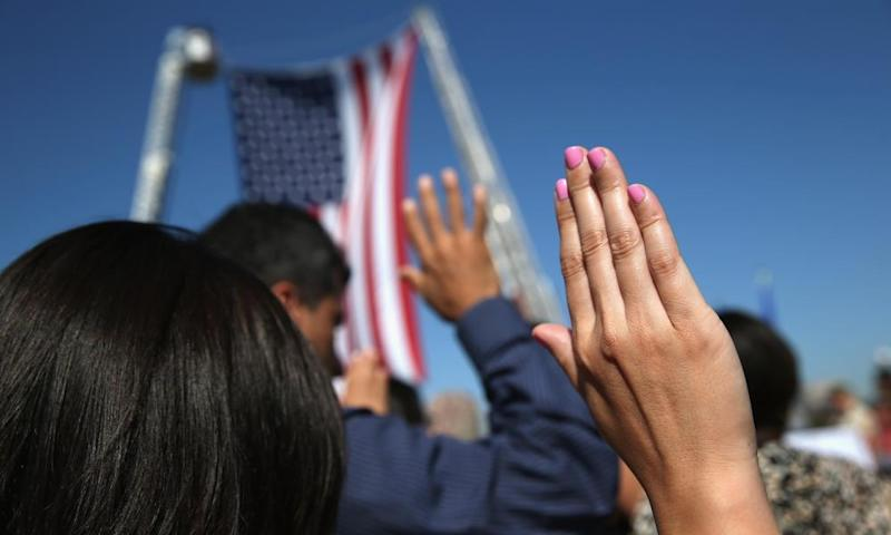 Immigrants become American citizens during a naturalization ceremony.