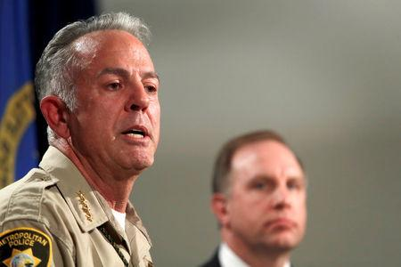 FILE PHOTO - Clark County Sheriff Joe Lombardo responds to a question during a media briefing at the Las Vegas Metro Police headquarters in Las Vegas, Nevada, U.S. October 3, 2017.  Aaron Rouse, FBI Special Agent in Charge of the Las Vegas Division, looks on at right. REUTERS/Las Vegas Sun/Steve Marcus