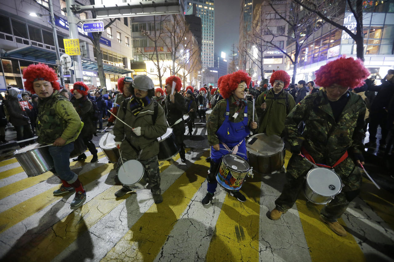 <p> FILE - In this Nov 26, 2016, file photo, protesters beat their drums as they march toward the presidential house during a rally calling for South Korean President Park Geun-hye to step down in Seoul, South Korea. Any good South Korean protest needs a soundtrack, and the music that accompanies the massive rallies on the verge of bringing down President Park includes the mournful, the tongue-and-cheek and a smattering of defiance. Music resounds in the crammed streets around South Korea's presidential palace. (AP Photo/Ahn Young-joon, File) </p>