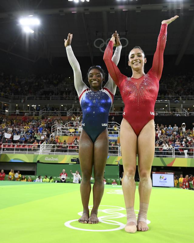 2016 Rio Olympics - Artistic Gymnastics - Final - Women's Individual All-Around Final - Rio Olympic Arena - Rio de Janeiro, Brazil - 11/08/2016. Silver medal winner Alexandra Raisman (USA) of the U.S. and gold medal winner Simone Biles (USA) of the U.S. celebrate. REUTERS/Dylan Martinez FOR EDITORIAL USE ONLY. NOT FOR SALE FOR MARKETING OR ADVERTISING CAMPAIGNS.