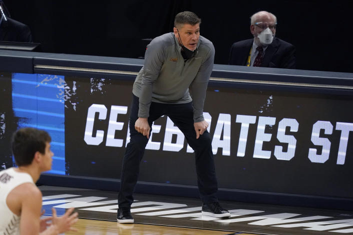 Loyola Chicago head coach Porter Moser watches from the bench during the first half of a Sweet 16 game against Oregon State in the NCAA men's college basketball tournament at Bankers Life Fieldhouse, Saturday, March 27, 2021, in Indianapolis. (AP Photo/Jeff Roberson)