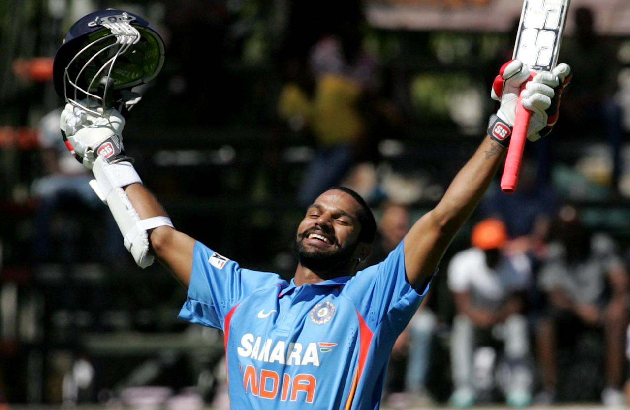 India batsman Shikhar Dhawan celebrates his century during the 2nd match of the 5 match cricket ODI series between hosts Zimbabwe and India at Harare Sports Club on July 26, 2013. AFP PHOTO/ Jekesai Njikizana.        (Photo credit should read JEKESAI NJIKIZANA/AFP/Getty Images)