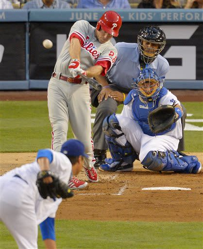 Philadelphia Phillies' Chase Utley hits a solo home run as Los Angeles Dodgers starting pitcher Ryu Hyun-Jin, of Korea, lower left, pitches and catcher A.J. Ellis catches while home plate umpire CB Bucknor looks on during the third inning of their baseball game, Saturday, June 29, 2013, in Los Angeles. (AP Photo/Mark J. Terrill)