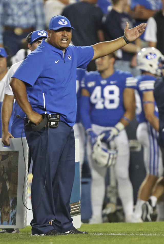 BYU coach Kalani Sitake yells at an official during the first half of the team's NCAA college football game against Utah, Thursday, Aug. 29, 2019, in Provo, Utah. (AP Photo/George Frey)