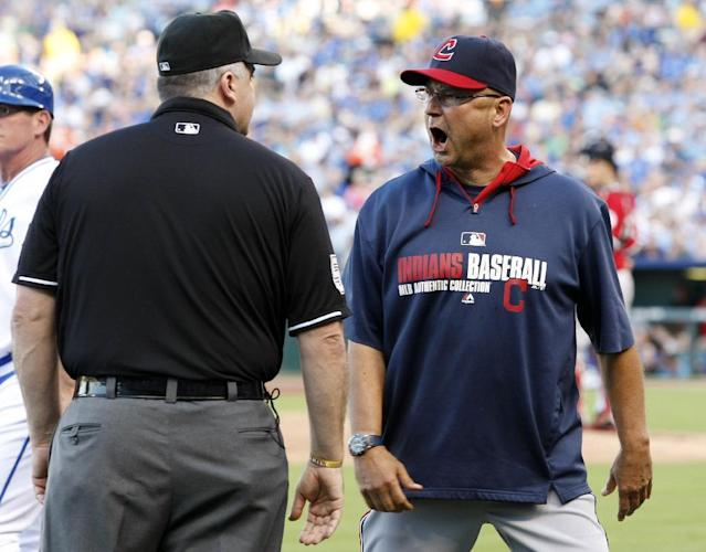 Cleveland Indians manager Terry Francona, right, argues with umpire Bill Welke after the third base official ejected Indians' pitching coach Mickey Callaway in the first inning of a baseball game against the Kansas City Royals in Kansas City, Mo., Saturday, Aug. 30, 2014. Callaway was tossed for disagreeing with a call. (AP Photo/Colin E. Braley)