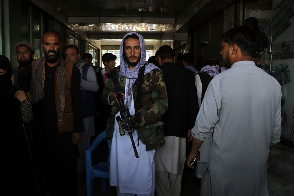 Sept. 4, 2021: Taliban fighters stand guard at a market in Kabul, Afghanistan.