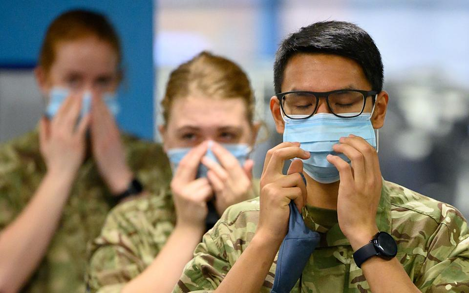 RAF personnel undertake PPE training at a leisure centre before being deployed to temporary remote testing sites  - Leon Neal/Getty Images Europe