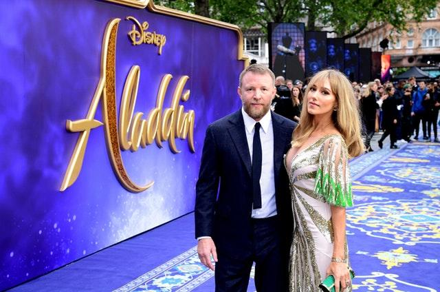 Director Guy Ritchie and wife Jacqui Ritchie arrive at the Aladdin premiere in London (Ian West/PA)