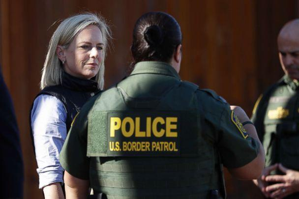 PHOTO: Department of Homeland Security Secretary Kirstjen Nielsen, left, speaks with Border Patrol agents near a newly fortified border wall structure, Oct. 26, 2018, in Calexico, Calif. (Gregory Bull/AP)