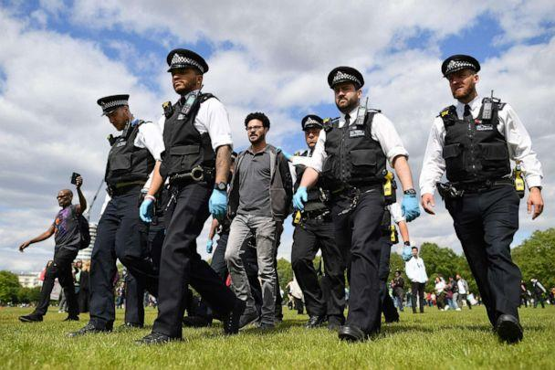 PHOTO: A man is led away by police officers at an anti-lockdown demonstration in Hyde Park in London, United Kingdom, on May 16, 2020, following an easing of restrictions in England amid the coronavirus pandemic. (Justin Tallis/AFP via Getty Images)