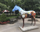 A horse sculpture stands outside the gate on the first day of horse racing at the Saratoga Race Course in Saratoga Springs, N.Y., Thursday, July 16, 2020. A Saratoga season like no other is underway, with fans barred from attending the start of the 152nd meet in track history and most likely the entire 40 days of racing. (AP Photo/John Kekis)