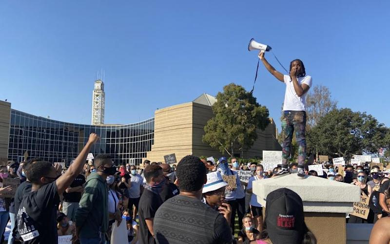 Khalil Mcleod, one of several black speakers from the community who took to the megaphone at a protest outside Irvine City Hall on Wednesday.