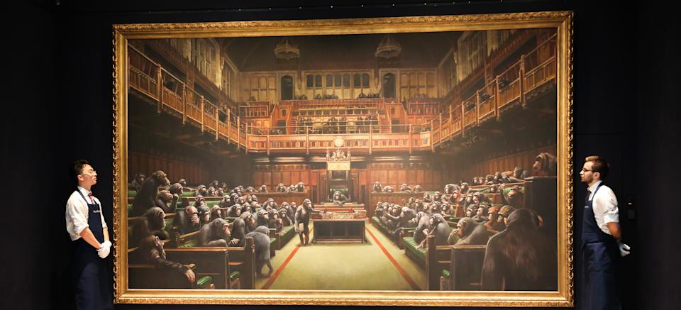 Sotheby�s technicians are seen in front of Banksy painting 'Dystopian, View of The House of Commons at London Sotheby's. The painting will be auctioned next month and is estimated at GBP1.5 to GBP2 million. (Photo by Steve Taylor / SOPA Images/Sipa USA)