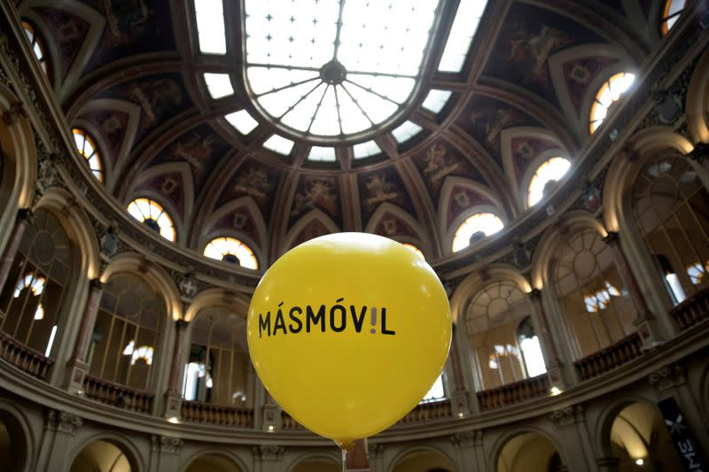 FILE PHOTO: A balloon with the logo of Masmovil is seen during its bourse debut in Madrid