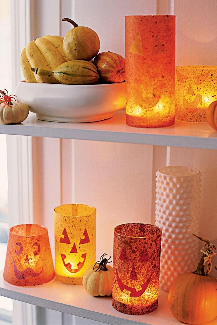 """<p>Lighten up your space with these pretty Jack-o'-Lantern votives, which you can display on any surface.</p><p><strong><em><a href=""""https://www.womansday.com/home/crafts-projects/how-to/a5882/craft-project-jack-o-lantern-votives-123860/"""" rel=""""nofollow noopener"""" target=""""_blank"""" data-ylk=""""slk:Get the Jack-o'-Lantern Votives tutorial"""" class=""""link rapid-noclick-resp"""">Get the Jack-o'-Lantern Votives tutorial</a>.</em></strong></p><p><a class=""""link rapid-noclick-resp"""" href=""""https://www.amazon.com/STARSIDE-Cylinder-Flowers-Wedding-Decrations/dp/B07L9TJWHF?tag=syn-yahoo-20&ascsubtag=%5Bartid%7C10070.g.2488%5Bsrc%7Cyahoo-us"""" rel=""""nofollow noopener"""" target=""""_blank"""" data-ylk=""""slk:SHOP GLASS VASES"""">SHOP GLASS VASES</a></p>"""